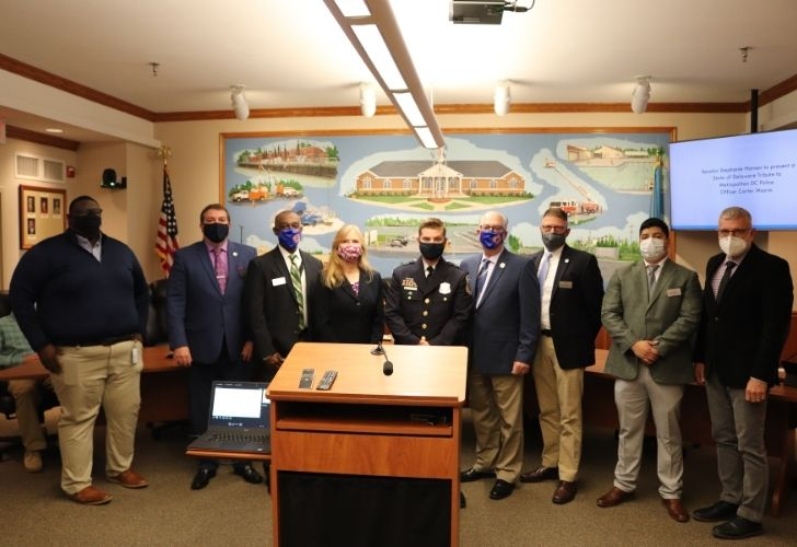 Seaford native, D.C. police officer Moore hailed as a hero during council meeting